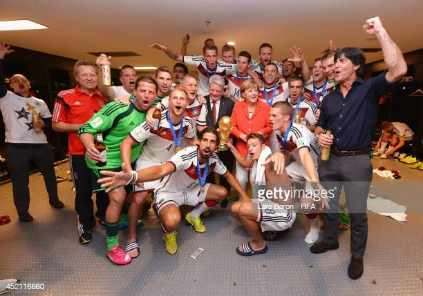 Head Coach Joachim Loew of Germany celebrates with players and Angela Merkel,Chancellor of Germany in the Germany dressing room after the 2014 FIFA...