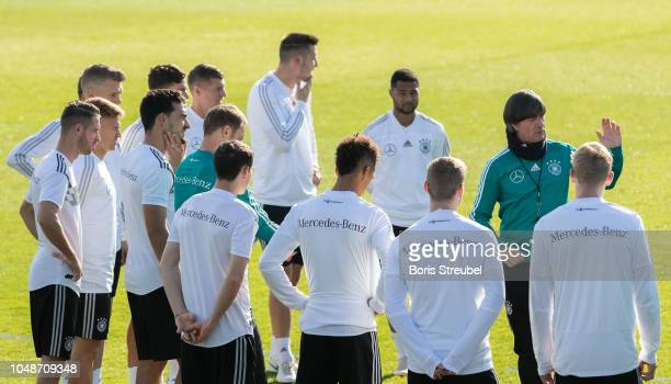 Head coach Joachim Loew of Germany gives advices to his team during a training session of the German national team at Stadion auf dem Wurfplatz on...