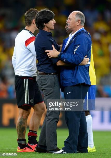 Head coach Joachim Loew of Germany is congratulated the win by Luiz Felipe Scolari of Brazil during the 2014 FIFA World Cup Brazil Semi Final match...