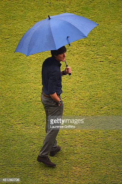 Head coach Joachim Loew of Germany looks on in the rain prior to the 2014 FIFA World Cup Brazil group G match between the United States and Germany...