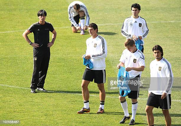 Head coach Joachim Loew of Germany looks to some of his players during a training session at Super stadium on July 1 2010 in Pretoria South Africa
