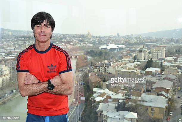 Head coach Joachim Loew of Germany poses for a photo on the 18th floor of the Radisson Blue hotel after a Germany press conference ahead of their...