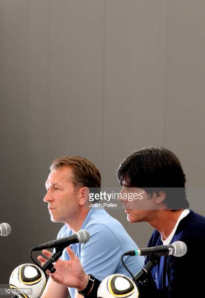 Head coach Joachim Loew of Germany speaks to the media sitting next to assisting coach Andreas Koepke during a press conference at Sportzone Rungg on...
