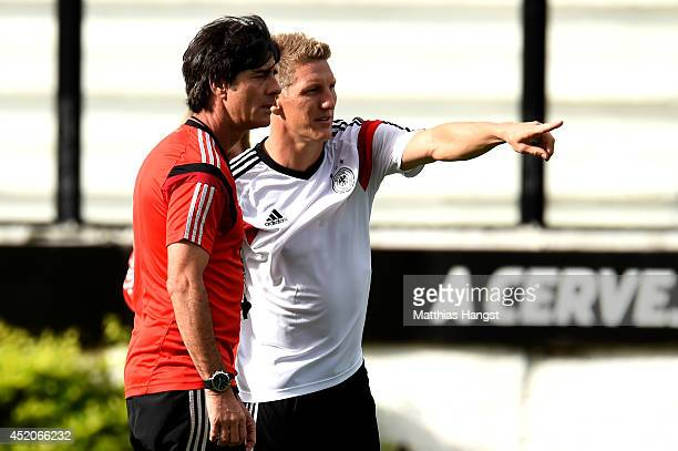 Head coach Joachim Loew of Germany speaks with Bastian Schweinsteiger of Germany during the Germany training session, ahead of the 2014 FIFA World...