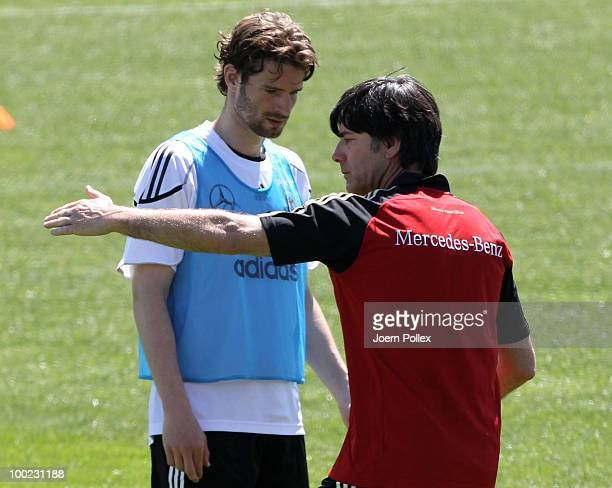 Head coach Joachim Loew of Germany talks to Arne Friedrich during a training session at Sportzone Rungg on May 22, 2010 in Appiano sulla Strada del...