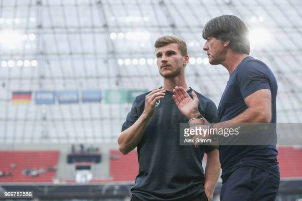 Head coach Joachim Loew of Germany talks to Timo Werner prior to the international friendly match between Germany and Saudi Arabia ahead of the FIFA...