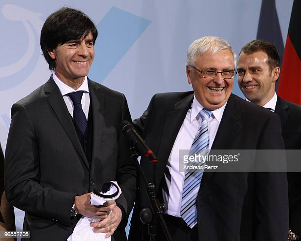 Head coach Joachim Loew of the German football national team and Theo Zwanziger president of the German Football Association smile at Chancellery on...