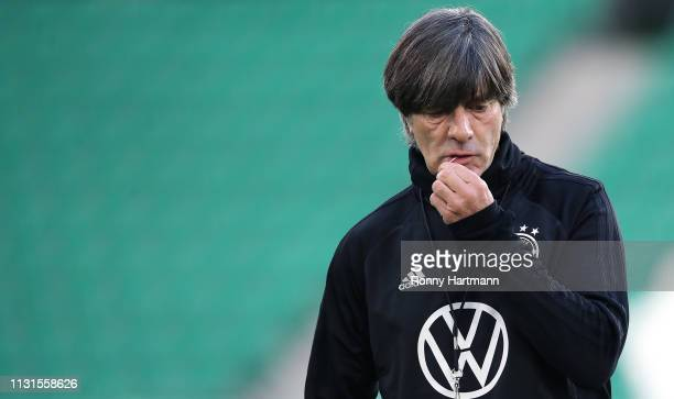 Head coach Joachim Loew of the German National Team handles with a chewing gum during a training session ahead of their friendly match against Serbia...