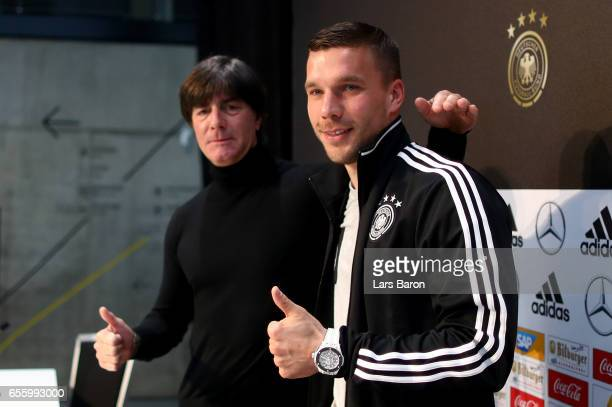Head coach Joachim Loew poses for a picture with Lukas Podolski a press conference of the German national team ahead of the international friendly...