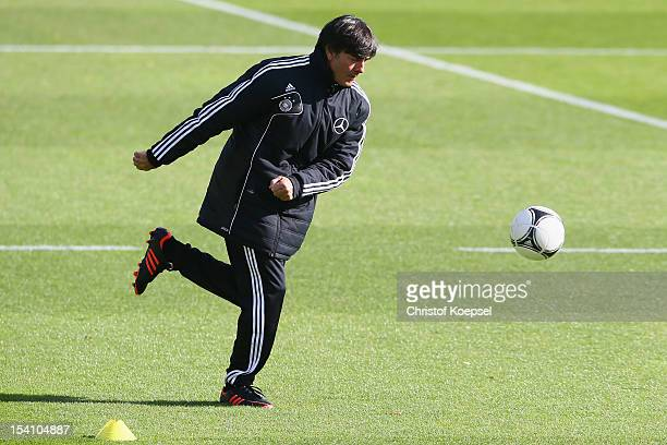 Head coach Joachim Loew shoots the ball during the training session of Germany at Amateur Stadium on October 14, 2012 in Berlin, Germany.