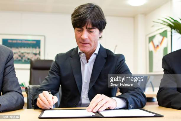 Head coach Joachim Loew signs his new contract during the announcement of the renewal of Joachim Loews contract at DFB headquarters on October 18...
