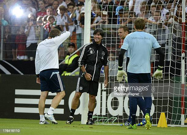 Head coach Joachim Loew smiles during the German National Football Team trainings session at Coface Arena on August 12 2013 in Mainz Germany The team...