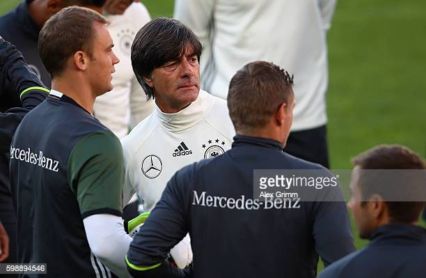 Head coach Joachim Loew stands next to newly announced team captain Manuel Neuer during a Germany press conference at Ullevaal Stadion on September 3...