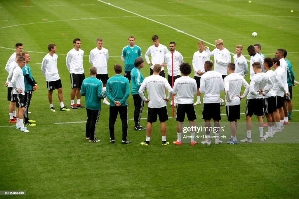 Head coach Joachim Loew talks to his team prior to a training session of the German national team at FC Bayern Campus on September 3, 2018 in Munich, Germany.