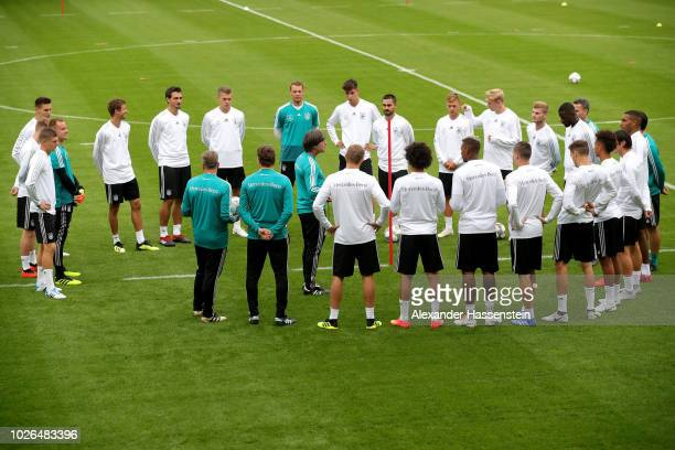 Head coach Joachim Loew talks to his team prior to a training session of the German national team at FC Bayern Campus on September 3 2018 in Munich...