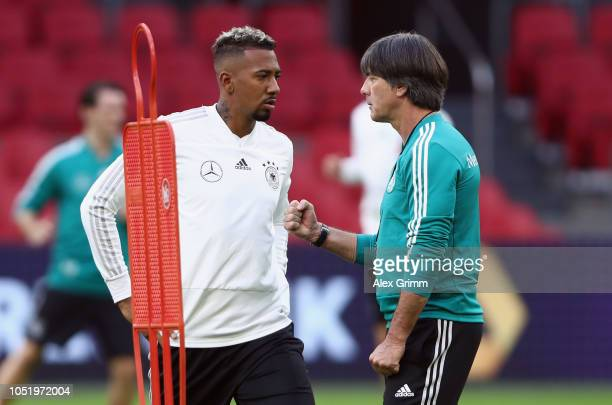 Head coach Joachim Loew talks to Jerome Boateng during a Germany traininkg session at Johan Cruyff Arena on October 12 2018 in Amsterdam Netherlands