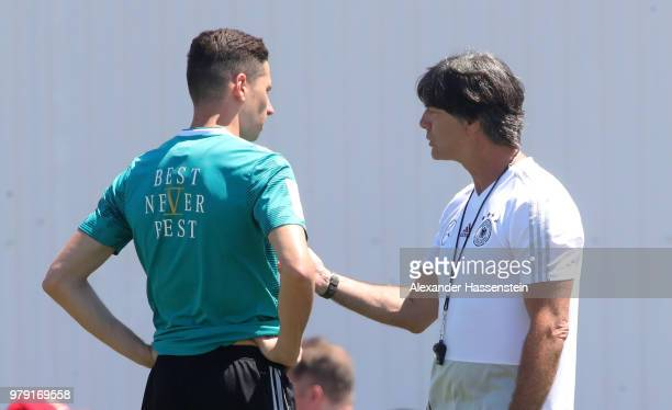 Head coach Joachim Loew talks to Julian Draxler during a Germany training session during the 2018 FIFA World Cup at Park Arena Training Ground on...