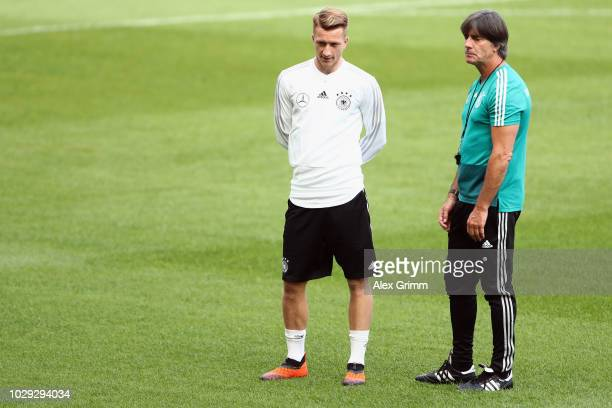Head coach Joachim Loew talks to Marco Reus during a Germany training session ahead of their International Friendly match against Peru at...
