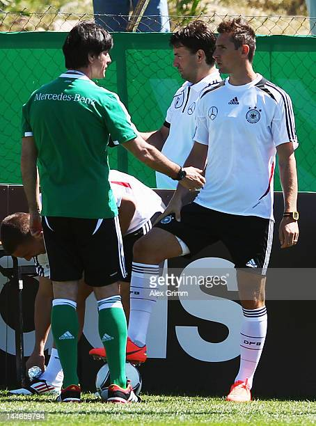 Head coach Joachim Loew talks to Miroslav Klose during a Germany training session at Campo Sportivo Comunale Andrea Corda on May 17 2012 in Abbiadori...