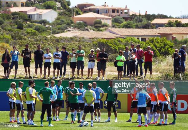 Head coach Joachim Loew talks to players during a Germany training session at Campo Sportivo Comunale Andrea Corda on May 17 2012 in Abbiadori Italy