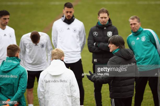 Head coach Joachim Loew talks to the players during a Germany training session ahead of their international friendly match against Spain at...