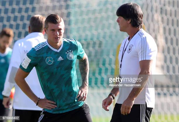 Head coach Joachim Loew talks to Toni Kroos during the Germany Training And Press Conference at Sport Base Vatutinki on June 15 2018 in Moscow Russia