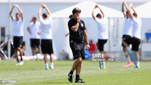 Head coach Joachim Loew walks past players during a Germany training session at Sotchi Parc Arena ahead of their FIFA Confederations Cup Russia 2017...