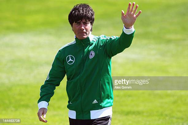 Head coach Joachim Loew waves to journalists after his arrival at a Germany training session at Campo Sportivo Comunale Andrea Dora on May 14 2012 in...