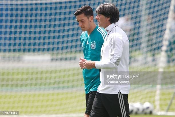 Head coach Joachim Low and player Mesut Ozdil are seen during the Germany national football team training session at the CSKA sports base ahead of...