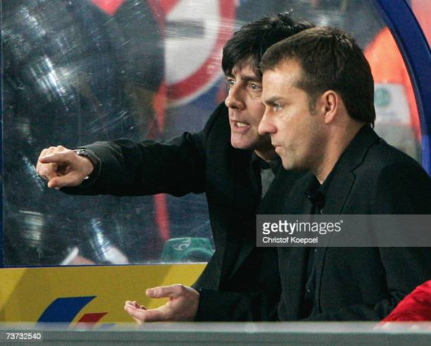 Head coach Joachim Low talks with his assistant coach Hans Flick of Germany during the international friendly match between Germany and Denmark at...