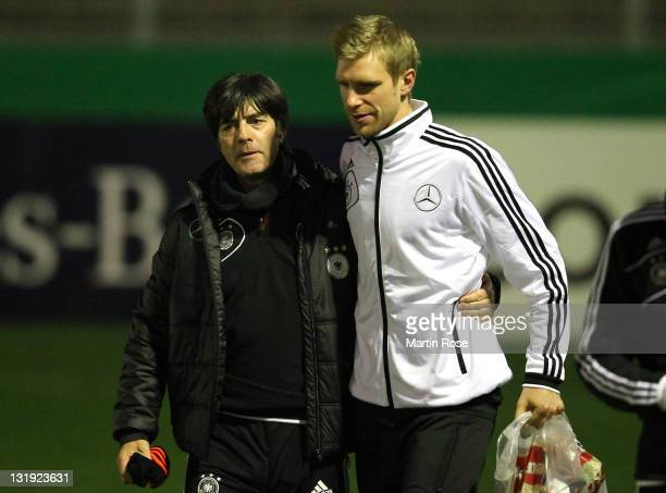 Head coach Joachm Loew talks to Per Mertesacker during the German National team training session at Victoria stadion on November 8 2011 in Hamburg...