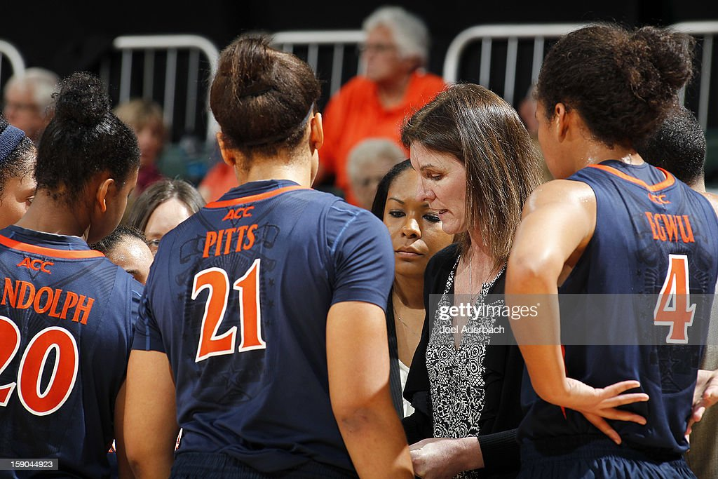 Head coach Joanne Boyle of the Virginia Cavaliers talks to her players after calling a time out against the Miami Hurricanes on January 6, 2013 at the BankUnited Center in Coral Gables, Florida. The Hurricanes defeated the Cavaliers 58-52.