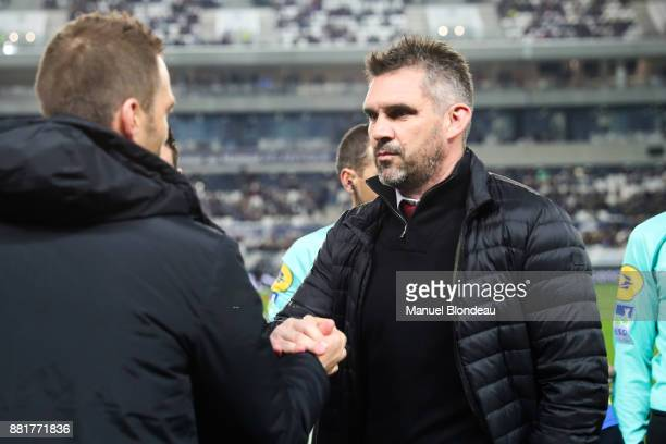Head coach Jocelyn Gourvennec of Bordeaux shakes hands with coach Julien Sable of Saint Etienne during the Ligue 1 match between FC Girondins de...
