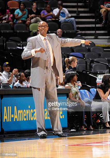 Head coach Joe Bryant of the Los Angeles Sparks calls a play during the Sparks game against the San Antonio Silver Stars at the ATT Center on July 12...