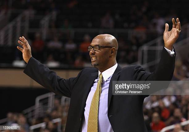 Head coach Joe Bryant of the Los Angeles Sparks reacts during the WNBA game against the Phoenix Mercury at US Airways Center on September 3 2011 in...