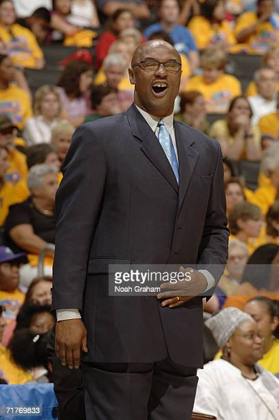 Head coach Joe Bryant of the Los Angeles Sparks watches the action from the sidelines against the Seattle Storm during the first round of the WNBA...