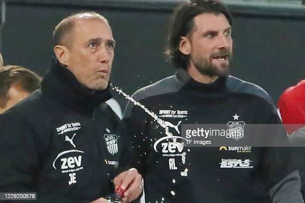 head coach Joe Enochs of FSV Zwickau and assistant coach Robin Lenk of FSV Zwickau look on during the 3 Liga match between Dynamo Dresden and FSV...