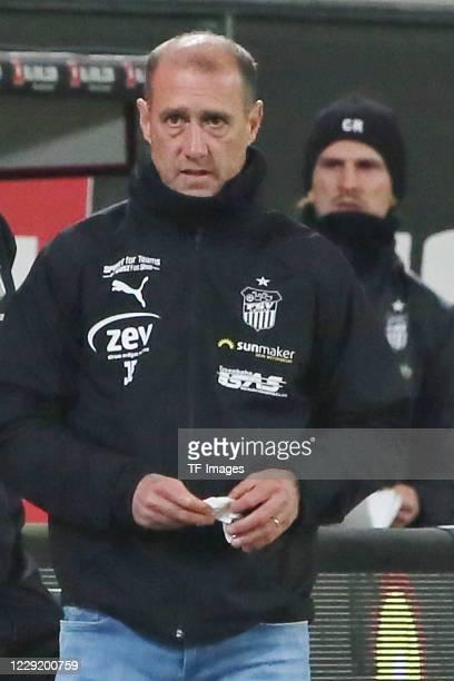 head coach Joe Enochs of FSV Zwickau looks on during the 3 Liga match between Dynamo Dresden and FSV Zwickau at RudolfHarbigStadion on October 20...