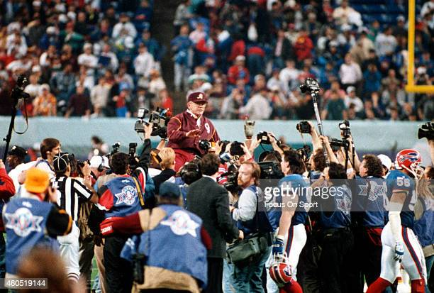 Head Coach Joe Gibbs of the Washington Redskins gets carried off the field after they defeated the Buffalo Bills in Super Bowl XXVI at the Metrodome...