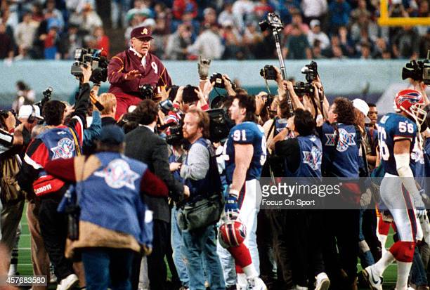 Head Coach Joe Gibbs of the Washington Redskins is carried off the field after they defeated the Buffalo Bills in Super Bowl XXVI at the Metrodome in...