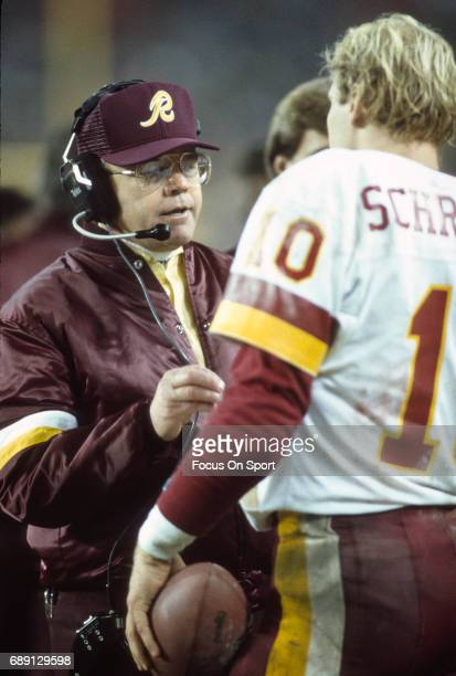 Head coach Joe Gibbs of the Washington Redskins looks on from the sidelines during an NFL football game circa 1984 at RFK Stadium in Washington DC...