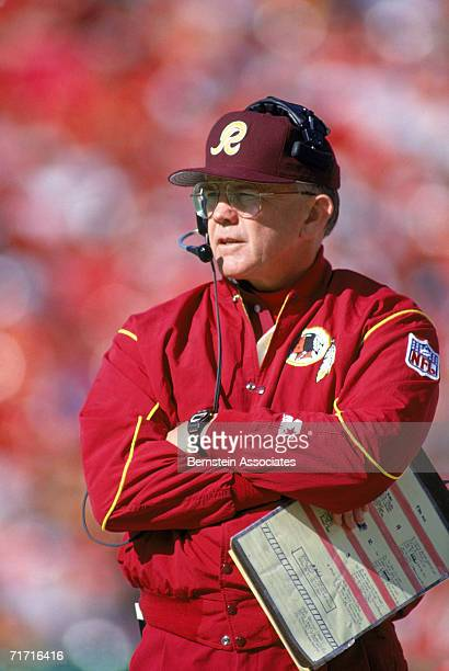 Head coach Joe Gibbs of the Washington Redskins looks on the field during a game against the Kansas City Chiefs on November 15 1992 in Kansas City...