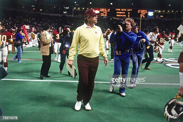 Head Coach Joe Gibbs of the Washington Redskins walks off the field after the game against the Dallas Cowboys on December 11 l983 in Irving Texas