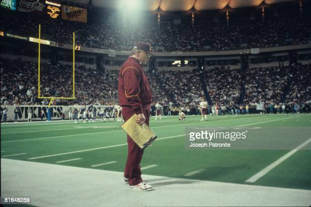 Head coach Joe Gibbs of the Washington Redskins watches from the sideline against the Minnesota Vikings in the 1992 NFC Wildcard Game at the...