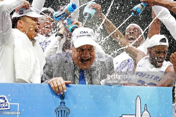 Head coach Joe Mihalich of the Hofstra Pride celebrates winning the CAA Men's Basketball Tournament - Championship college basketball game against...
