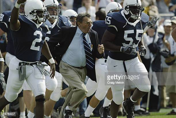 Head coach Joe Paterno leads his Pennsylvania State University Nittany Lions onto the field prior to the game against the Temple University Owls at...
