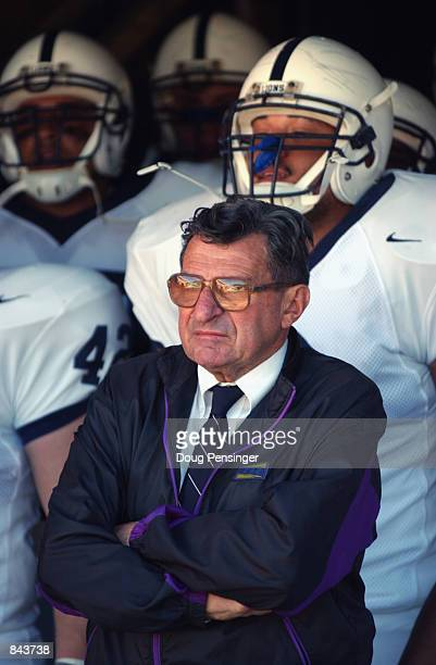 Head coach Joe Paterno of the Penn State Nittany Lions stands in front of his players before the NCAA football game against the Virginia Cavaliers on...