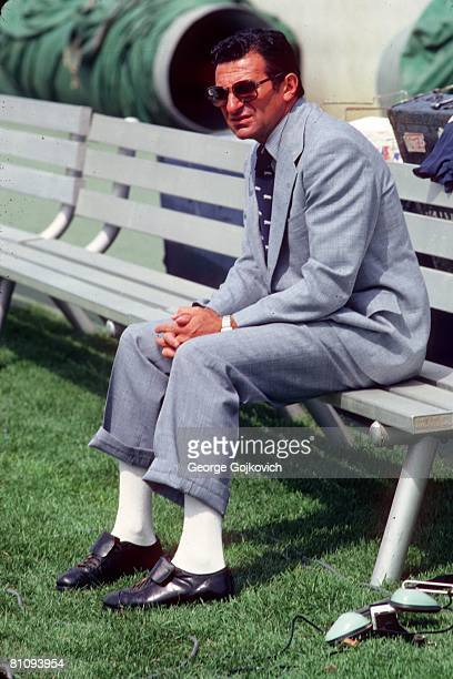 Head coach Joe Paterno of the Penn State University Nittany Lions sits on a bench on the sideline before a college football game at Beaver Stadium in...