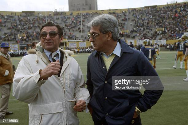 Head coach Joe Paterno of the Penn State University Nittany Lions talks with head coach Foge Fazio of the University of Pittsburgh Panthers before a...