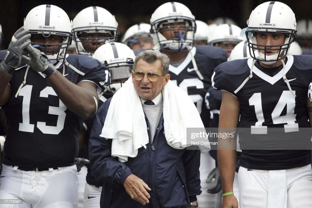 Head coach Joe Paterno walks onto the field with Defensive Tackle Jay Alford #13 and Quarterback Anthony Morelli #14 of the Penn State Nittany Lions prior to the game against the University of Akron Zips at Beaver Stadium on September 2, 2006 in State College, Pennsylvania.